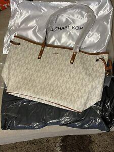 Michael Kors travel large white drawstring bag with Michael Kors logo wristlet