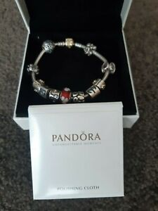Authentic Pandora Bracelet & 11 Charms, Silver with Gold Clasp. Great condition