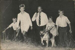Political Happy Thanksgiving and re-election bid 1972. Family walking up hillsid