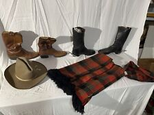 Western Boots, A Stetson Hat, And A Western Style Poncho