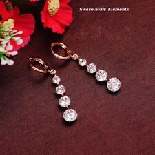 Boucles d'oreille pendantes dorées  4 rangées Swarovski® Elements TRANSPARENTS