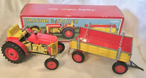 VINTAGE SCHYLLING TRACTOR & TRAILER, WIND-UP POWERED 4-POSITION GEAR~8 & UP,NEW.