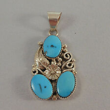 KEITH JAMES - .925 STERLING SILVER TURQUOISE PENDANT WITH LEAF, FLOWER & SCROLLS