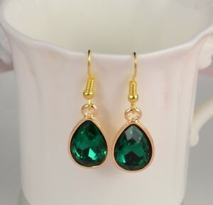 SMALL GOLD TONE TEAR DROP EARRINGS WITH DARK GREEN DIAMANTE FACETED CRYSTAL