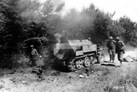 WWII photo US soldiers inspecting the burning German semi-tracked armored 1301