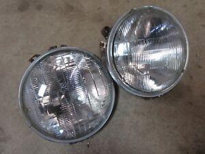 1977 Pontiac Ventura exterior front headlight bulb trim ring mounting cup pair