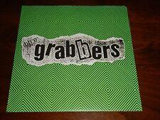 The Grabbers 45 rpm Record, Huntington Vs the World - The Way I Am / Three 1993
