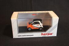 "Herpa Smart City Coupé 1:43 White / Orange ""TNT"" (JS)"