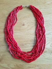 Red multi strand bead necklace