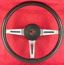 Genuine OEM  MG MGB GT Midget black leather steering wheel and horn button.  5B