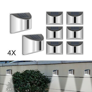 Four LED solar garden wall fence lights outdoor garden terrace wall lights