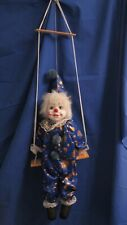 Clown Or Puppet On Swing Has Porcelain Face