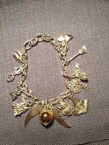 womans charm bracelet Disney themed. harry potter quidditch.