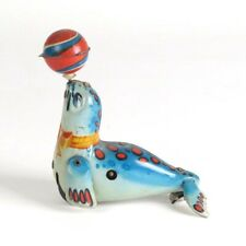 Tin wind up toy seal with ball no key as is
