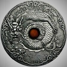 Togo 2012 1,500 Francs CFA Year of / Année du Dragon 2 Oz Silver Coin with Amber