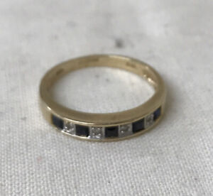 9ct Gold Ring With black sapphire and diamonds