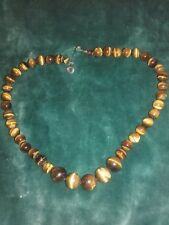 Tiger'S eye necklace,  STRUNG ON STEEL WIRE , hand made polished stone.
