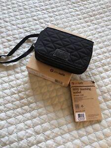 Pacsafe Anti Theft Bi-Fold Travel Wallet with RFID Black Peach and Black