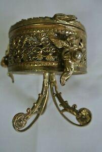 VINTAGE FILIGREE FOOTED CHERUB ORMOLU JEWELRY TRINKET BOX  BEVEL GLASS