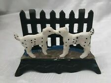 CAST IRON LETTER RACK WITH FENCE AND DALMATIAN DOGS.