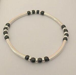 Sterling Silver And Black Hematite Gemstone Beaded Noodle Tube Stretch Bracelet.
