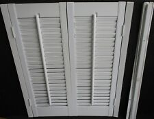 "INTERIOR  WHITE VINYL WINDOW SHUTTERS w/ LOUVERS 23"" wide x 28""  high"