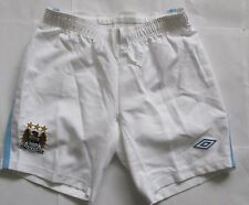 MANCHESTER CITY BOYS HOME SHORTS BY UMBRO SIZE LARGE BOYS BRAND NEW WITH TAGS