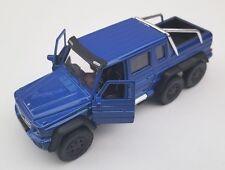 Livraison rapide MERCEDES G 63 AMG 6x6 bleu/Blue welly modèle auto 1:34 nouveau OVP