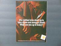 1995 Carhartt Clothing Has stood up to Bear Claws & Shotgun blasts print ad