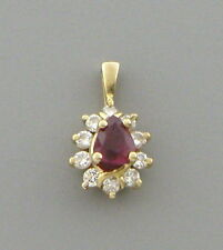 14K YELLOW GOLD RUBY AND DIAMOND PENDANT 0.50ct