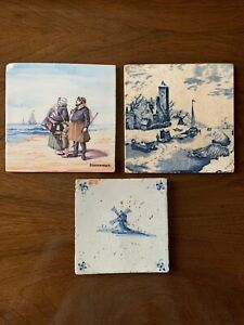 Lot of 3 antique hand painted Delft tiles. One signed.