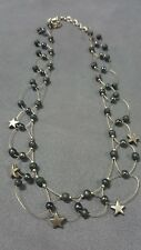 5 STAR NECKLACE BY ROBERT ROSE, BLACK BEADS ON FLOATING WIRE