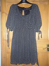 Black & White Polka Dot Robe. taille 10.