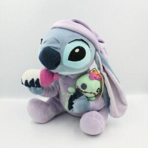 Peluche Stitch avec monstre et biberon Lilo et Stitch DISNEYLAND - Extra Terrest