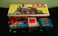 """Vintage MF 712 Friction Powered Tin Locomotive 8"""" Long and 4"""" Tall in Box"""