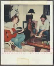 Vintage SX70 Polaroid Photo Men Playing Guitar Music in Home Interior 698660