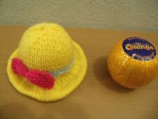 Knitting pattern AND WOOL to make an Easter bonnet chocolate orange cover
