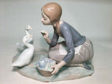 """collectible vintage porcelain figurines Lladro #4849 """"Food for Ducks"""" girl /duck"""