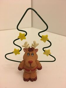 Cute Reindeer Figure Holding A Wire Xmas Tree Decoration