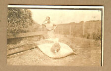 Early 1900s Woman at Hay, Straw Stack Filling Mattress Real Photo postcard