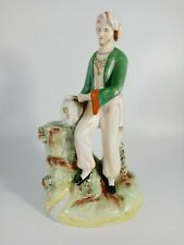 More details for unusual staffordshire flat back figure of an man wearing a turban holding an urn