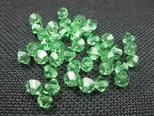 40 Glasschliffperlen Doppelkegel 4mm grün Perlen 7781