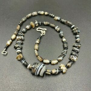 A beautiful collection of agate beads along with carved animals figure beads