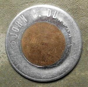 John J. Duncan. Encased 1c, 35mm, major error – cent & the frame got obliterated