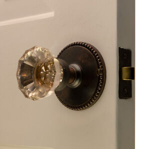 The Orlean Passage Set in Polished Brass with Oval Door Knobs