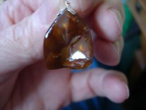 fire agate pendant with silver mounting