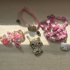 hello kitty accessories set: pin, necklace, bracelet, and hair ties