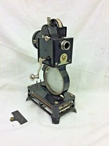 Pathe Baby Cine Projector, cased, hand cranking with 28 films for restoration.