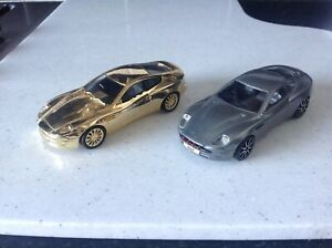 2 large James Bond , jaguar , 1/36 models heavy , gold plated ?'not sure, corgi