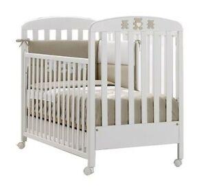 Lettino neonato usato, come nuovo, comprensivo di materasso, paracolpi e coprium